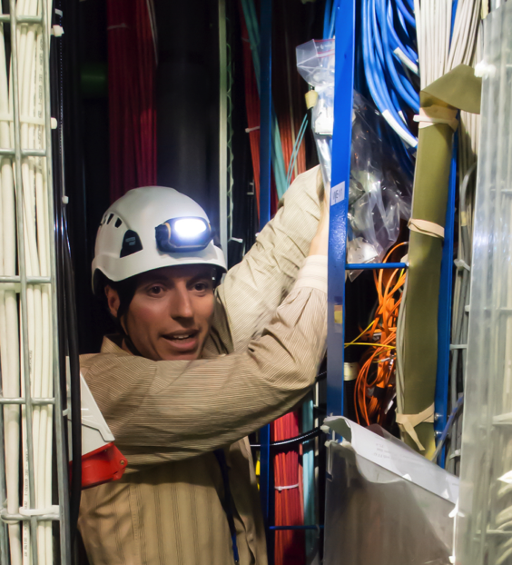 Manuel Franco Sevilla installs ODMB modules into the CMS detector at CERN. (Photo: Jeff Richman)